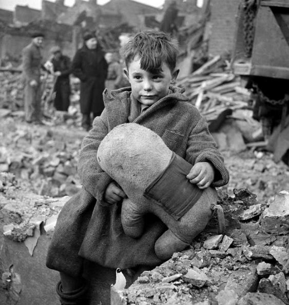 Abandoned boy holding a stuffed animal london 1945 colorization